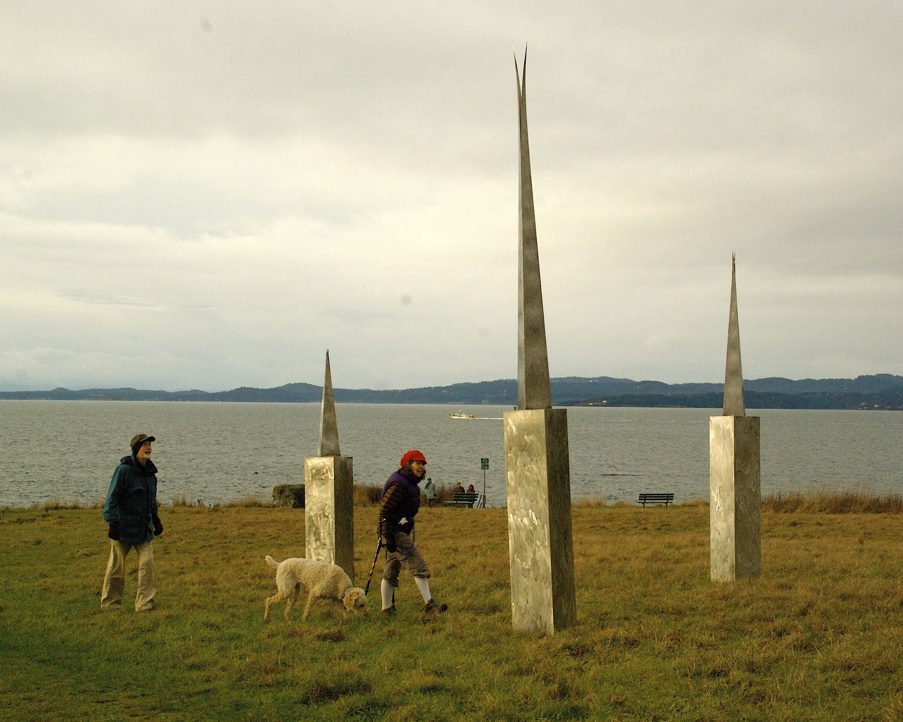 Picture of sculpture showing people beside it for scale.